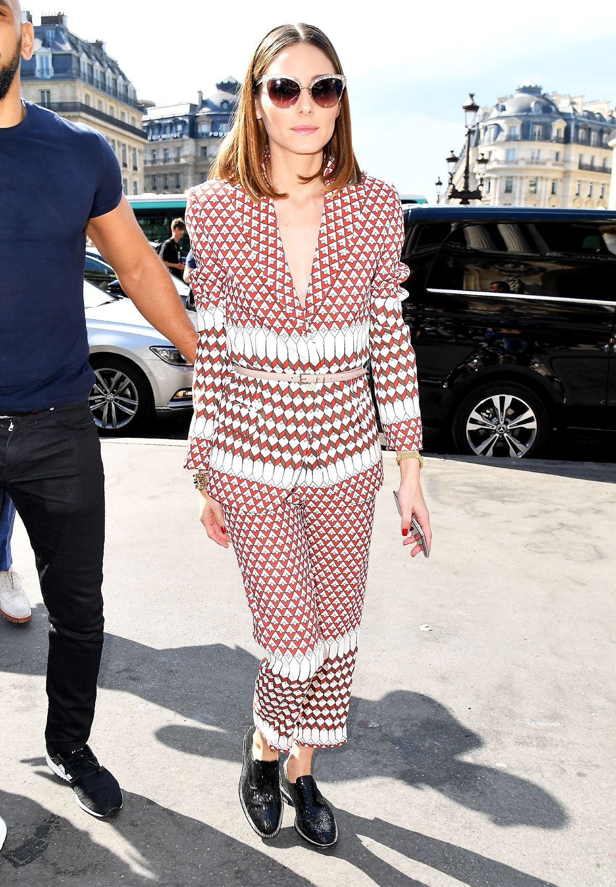 5f28ab1142 Style Notes  Olivia manages to change the entire vibe of her printed suit  by wearing it buttoned up