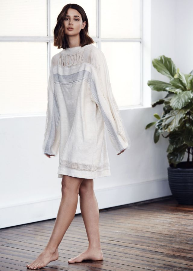 "<p><em>Credits: Bassike <a href=""https://www.bassike.com/collections/index/set/id/r15lookbook"" target=""_blank"">Embroidered Fringe Tunic</a> ($550). </em></p>"