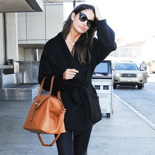 16 Airport-Worthy Coats to Survive Chilly Flights