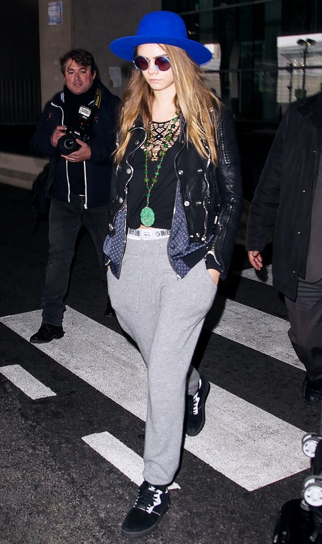 <p>Cara Delevingne dressed comfortably for her jet-setting, opting for sweatpants and sneakers. But with the addition of a leather jacket, the outfit felt instantly updated.</p>