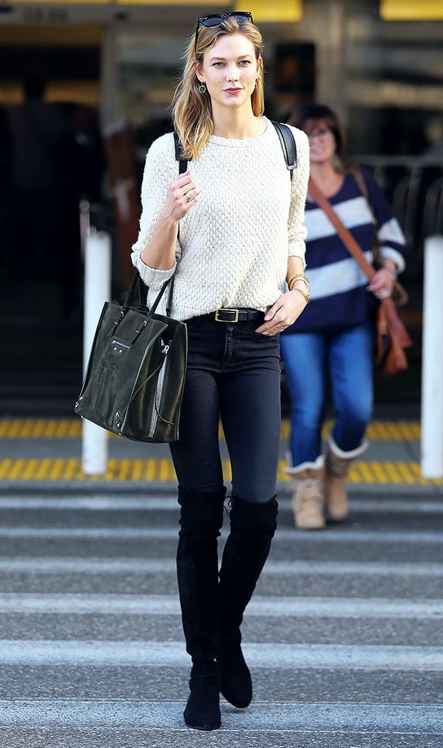 <p>Karlie Kloss went for a classic look, styling her over-the-knee boots with skinny jeans and a comfy sweater.</p>