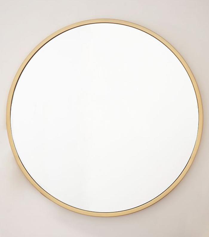 11 ways to style large round mirrors mydomaine