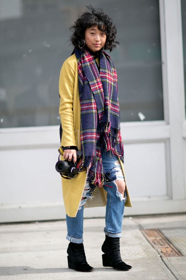 <p>Wear a scarf over your coat to add different lengths and layers.</p>
