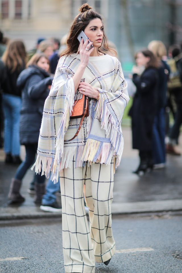 <p>A poncho will keep you warm, but it still makes your outfit unique.</p>