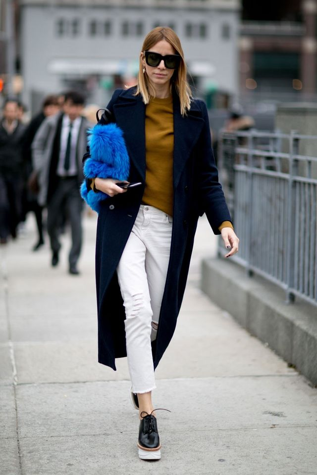 <p>A statement bag takes a simple winter look to the next level.</p>