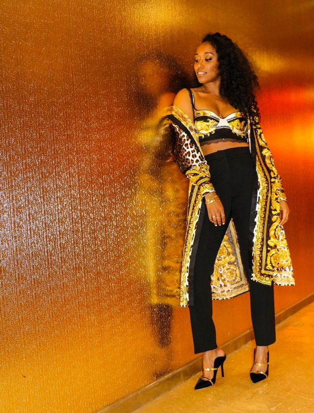 What to wear on a night out: Shiona Turini wearing a baroque printed bralette and coat