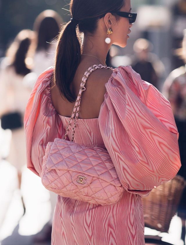 What to wear on a night out: Anna Vitiello wearing a pink silk moiré dress and pink Chanel bag