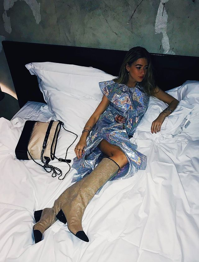 What to wear on a night out: Emili Sindlev wearing a metallic dress with glittery Chanel boots
