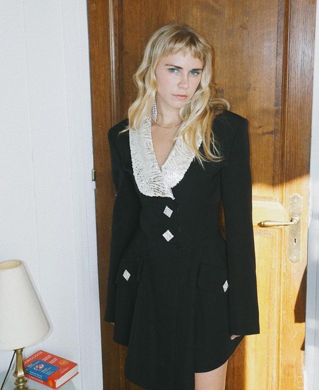 What to wear on a night out: Courtney Trop wearing a black dress with crystal buttons and collar