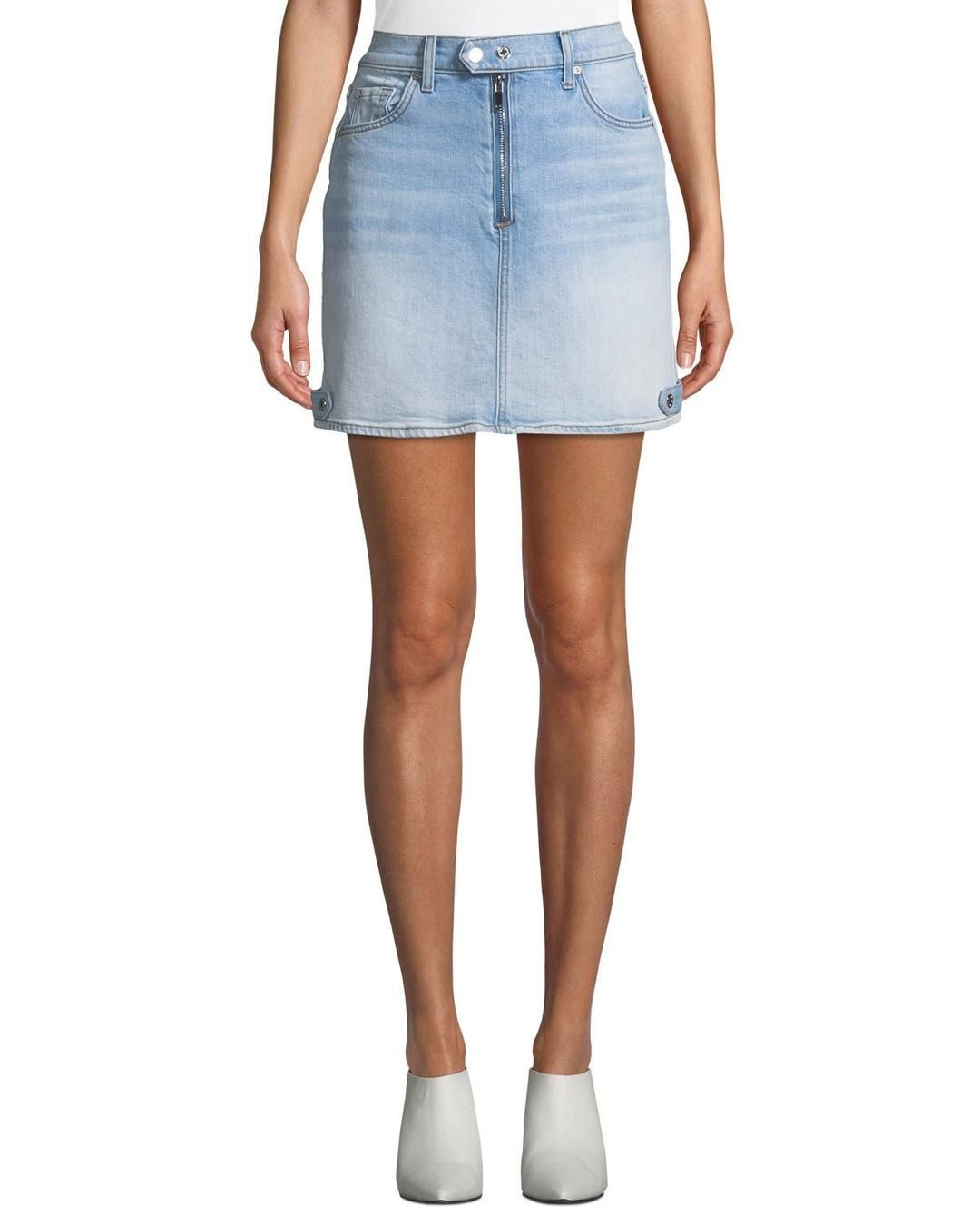 75f092a7adf10 What cooler way to wear a denim miniskirt than styled with an all-black  look, including a sleek leather jacket?