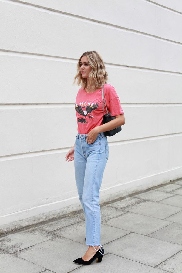 Adenorah in a red T,shirt and vintage Levi\u0027s jeans