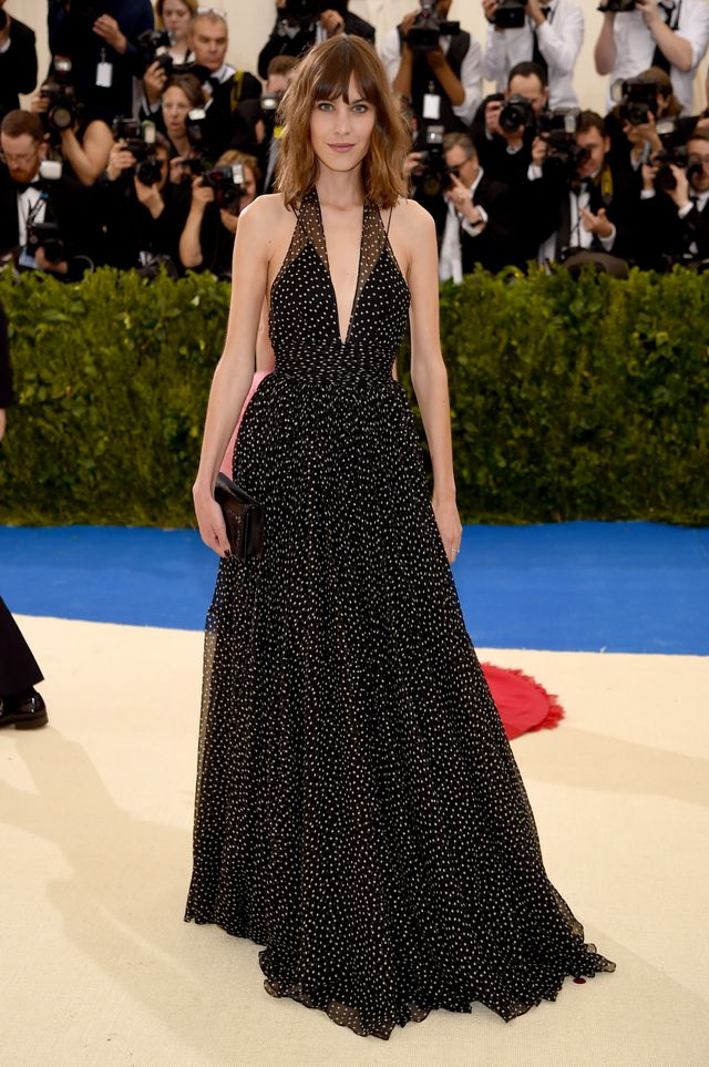 <p><strong>WHO:</strong> Alexa Chung</p> <p><strong>WEAR:</strong> Diane von Furstenbergdress cut from semi-sheer crinkle chiffon with a screen-printed polka dot pattern in black and ivory. The...