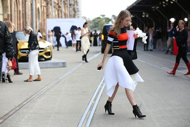 <p>It's easy to always rely on a black and white uniform, but be daring and add a splash of colour. </p>