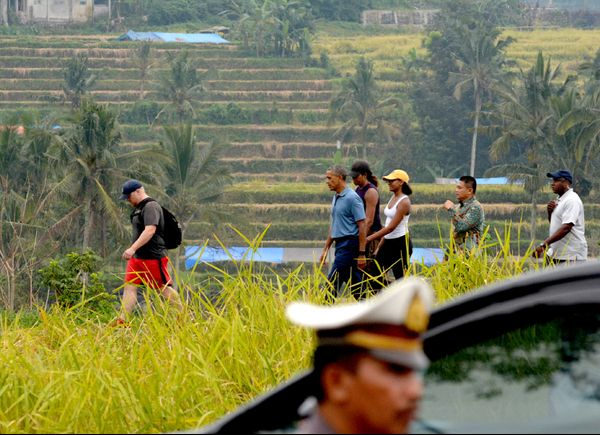 """<p>This past Saturday, June 24, the Obama family was spotted walking through a field near the stunning <a href=""""http://www.bali-indonesia.com/magazine/jatiluwih-rice-terraces.htm""""..."""