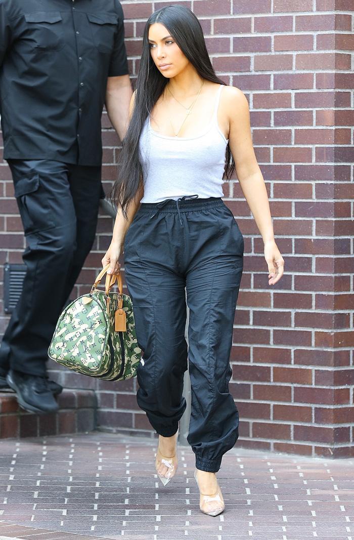 75bbad45390 On Kim Kardashian West  Hermés Kelly bag. Pinterest
