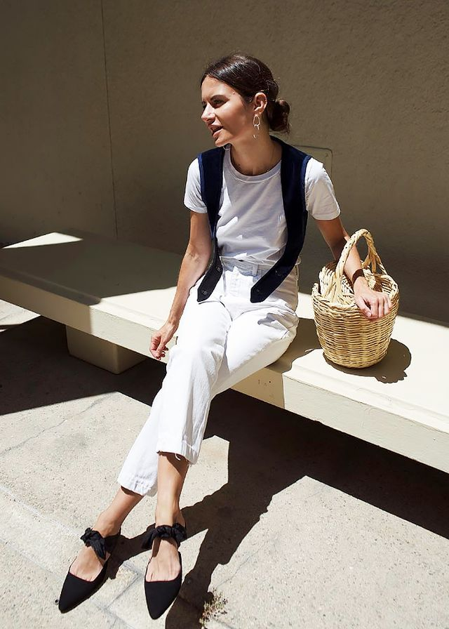 Marta Cygan in a white outfit with a basket bag