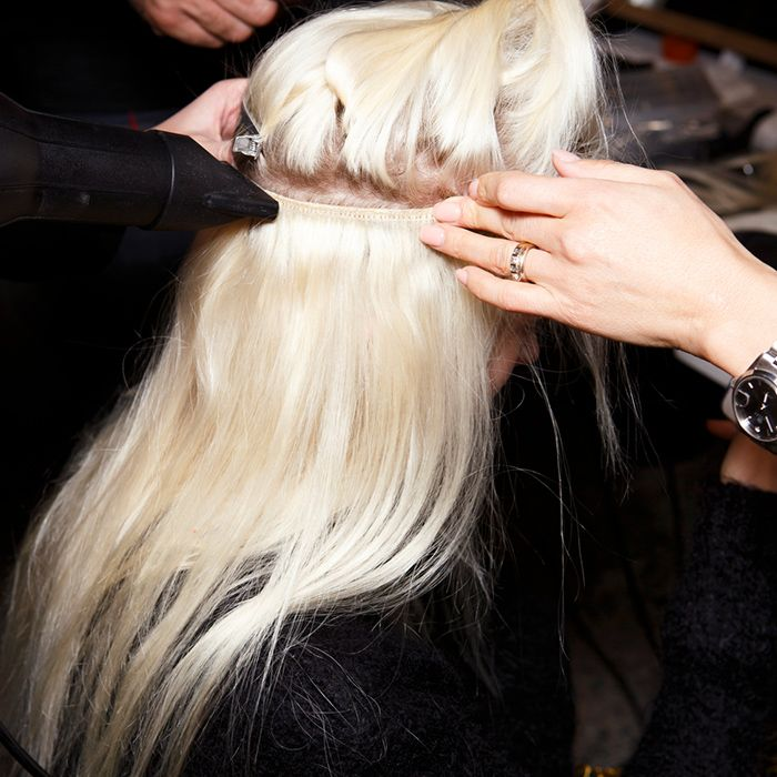 Everything You Need To Know About Tape In Extensions Byrdie Uk