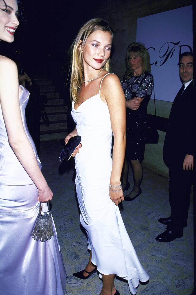 90s fashion: Kate Moss wearing a white slip dress