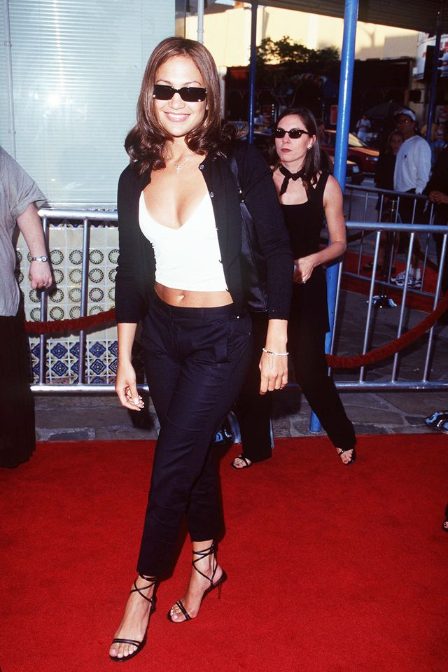 90s fashion: Jennifer Lopez in a monochrome outfit with strappy heels