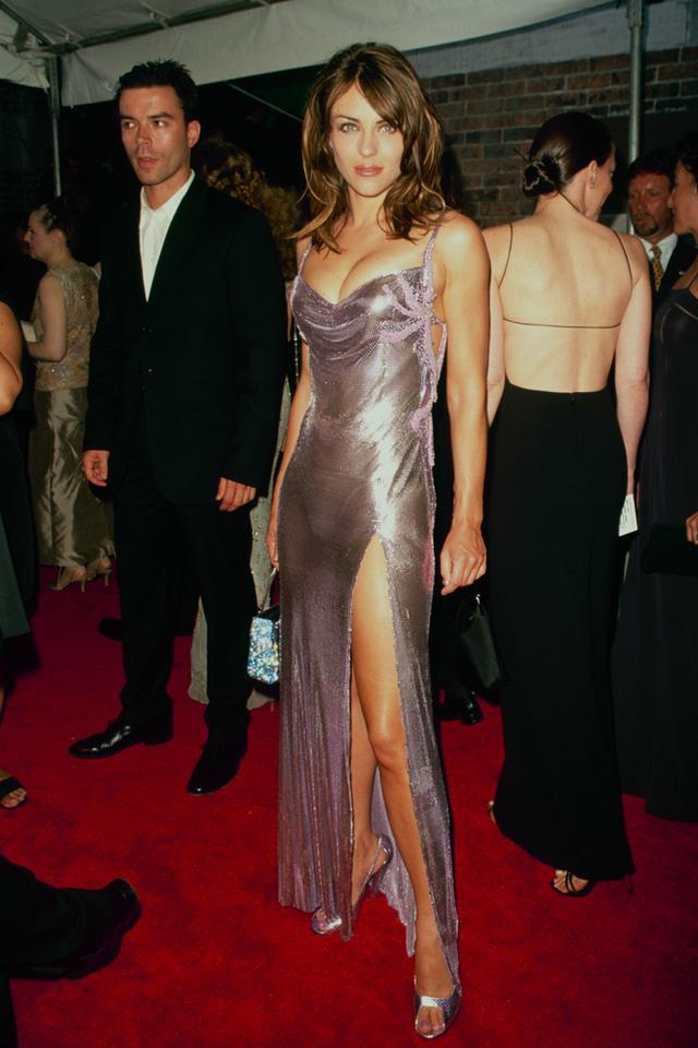 90s fashion: Liz Hurley wearing a chainmail dress