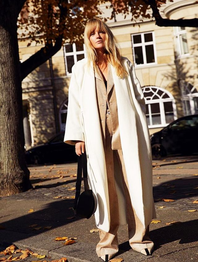 Influencers wearing high street: Jeanette Madsen in Mango white coat