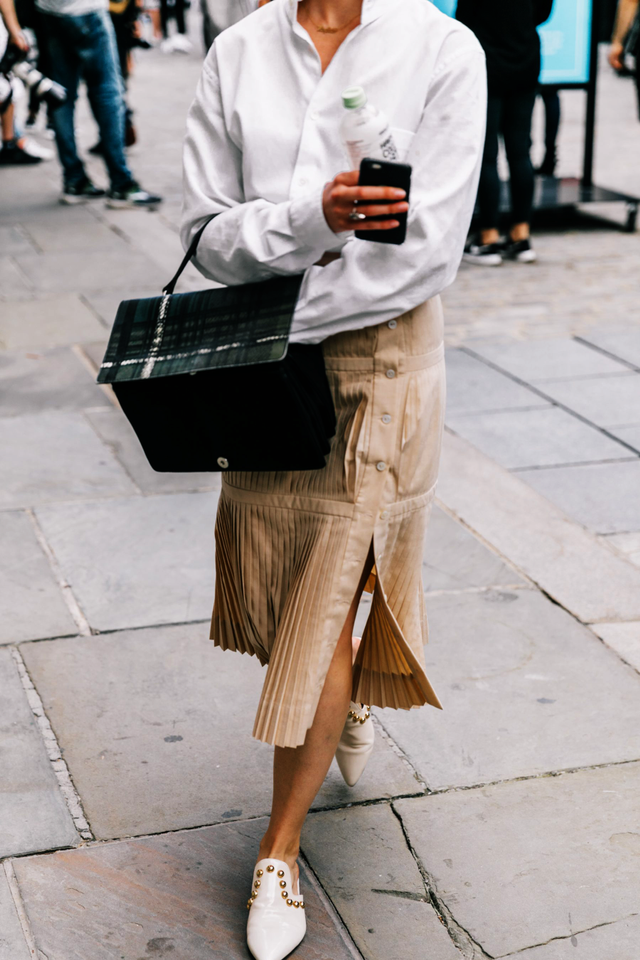 Street style white shirt and tan skirt with black bag
