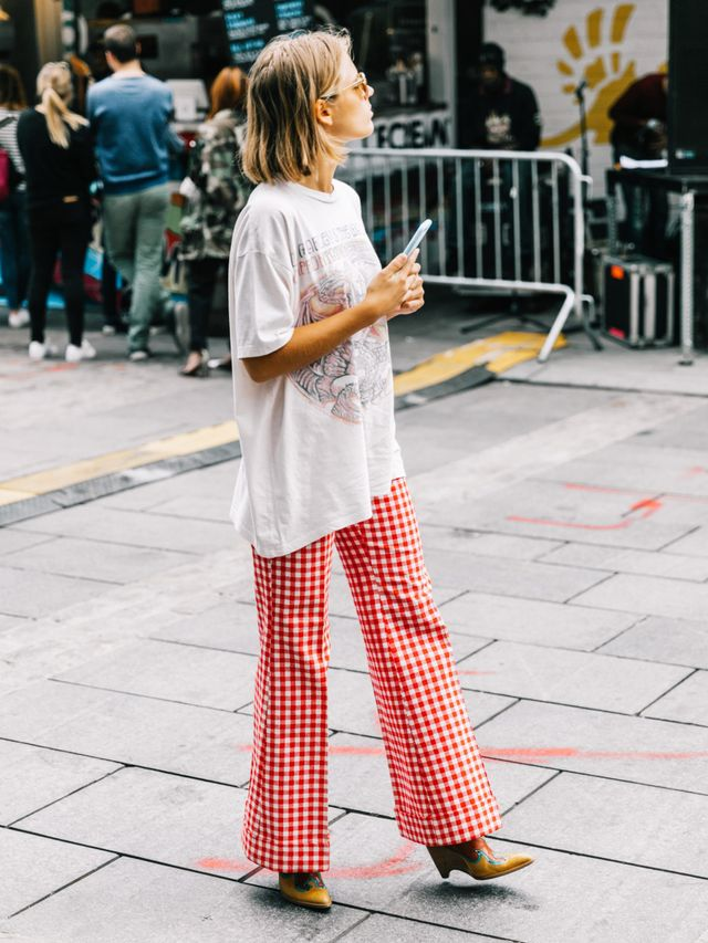 <p>The vintage band tee shirt is soversatile to wear, even if it doesn't feel like it immediately fits into your personal style. If your wardrobe leans towards a more feminine vibe, pair the...