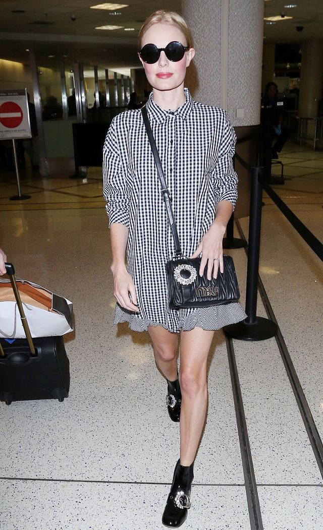 Kate Bosworth wearing a checkered dress and boots at airport