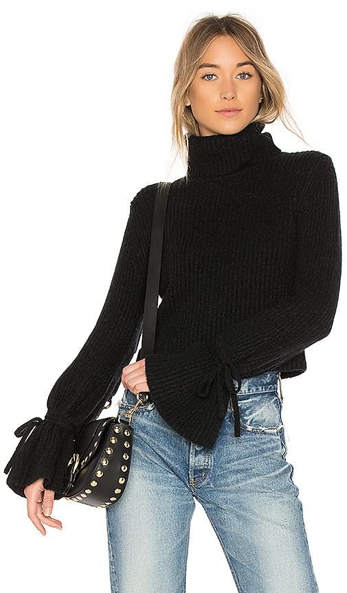469c869fc4 The Best Black Sweaters to Wear With Skinny Jeans