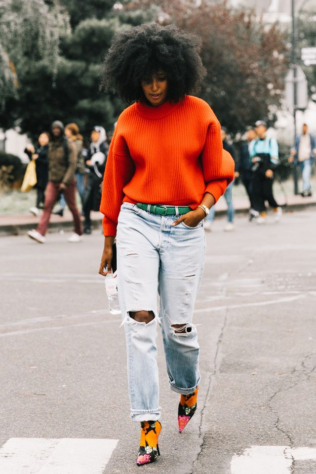 <p>A bold sweater flaunting your team's colors is an easy pairing with boyfriend jeans. Add a pair of playful heels in a coordinating colorway to make your look party-ready.</p>