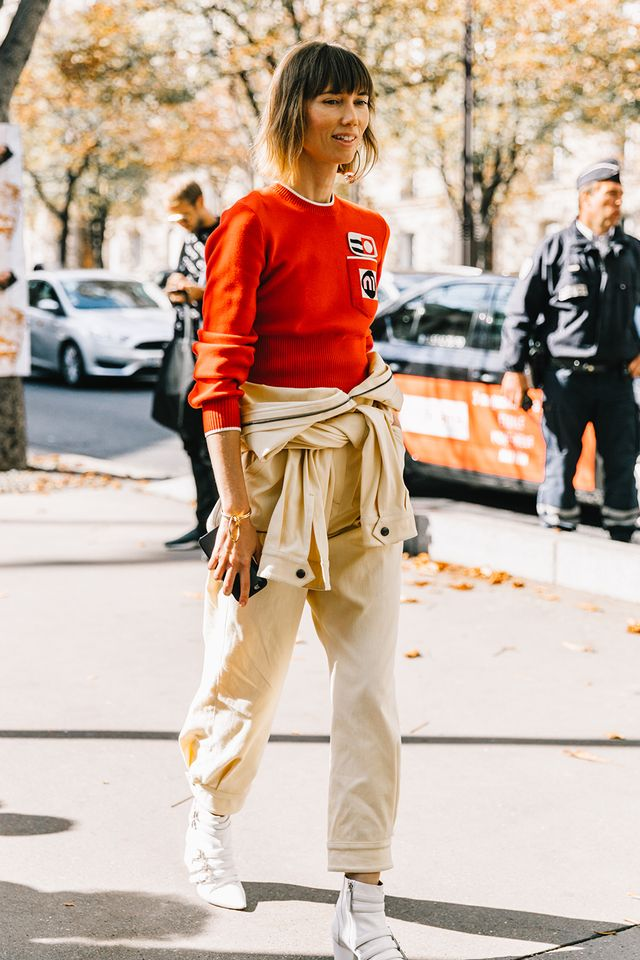 <p>Top off a jumpsuit and sneaker look with a sweater in your team's colors for a distinctive statement.</p>