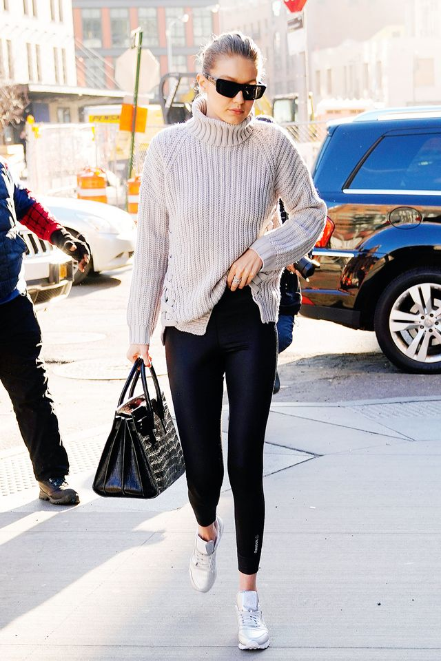 <p>Ensure major comfort when you gather on the couch with a ribbed-knit sweater, black leggings, and sneakers.</p>