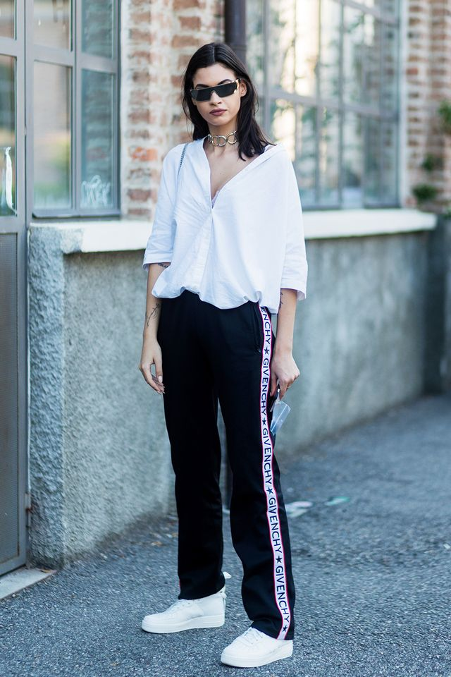 <p>A crisp button-down paired with track pants and white sneakers never looked cooler.</p>