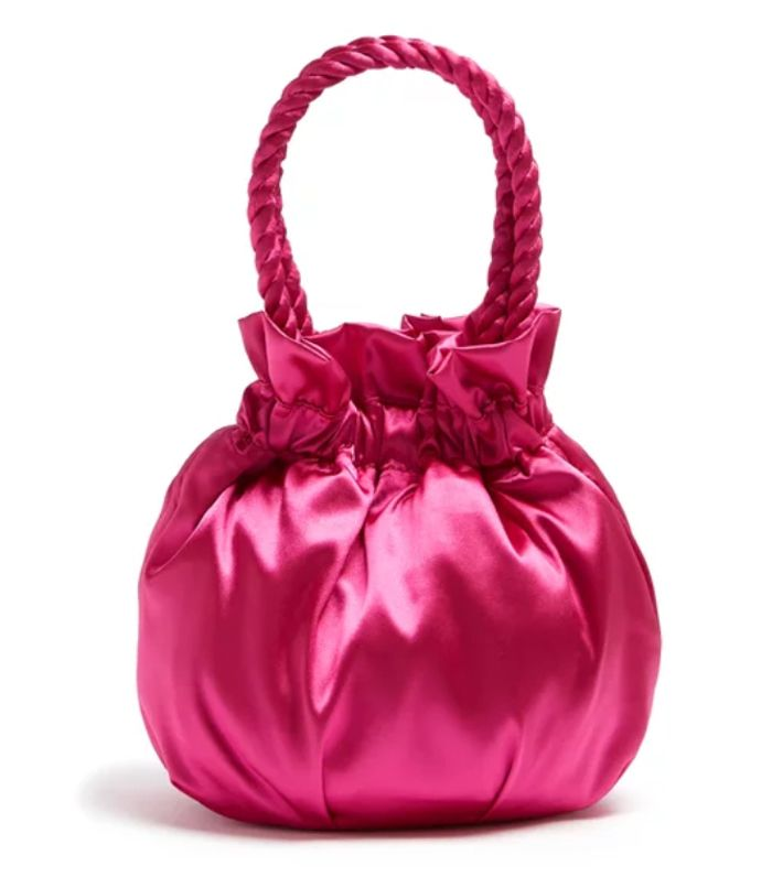 03baa44a1710 Pinterest · Shop · Staud Grace Satin Clutch Bag (£198). This satin clutch  bag will brighten up any outfit.