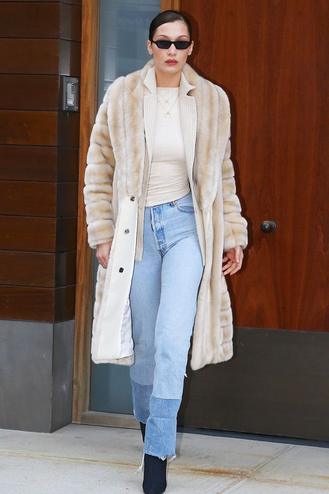 Bella Hadid boyfriend jeans fur coat sunglasses street style