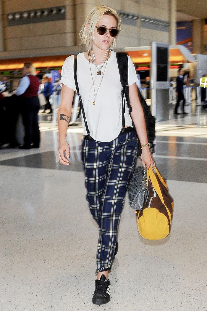 celebs love these plaid pant outfits  who what wear
