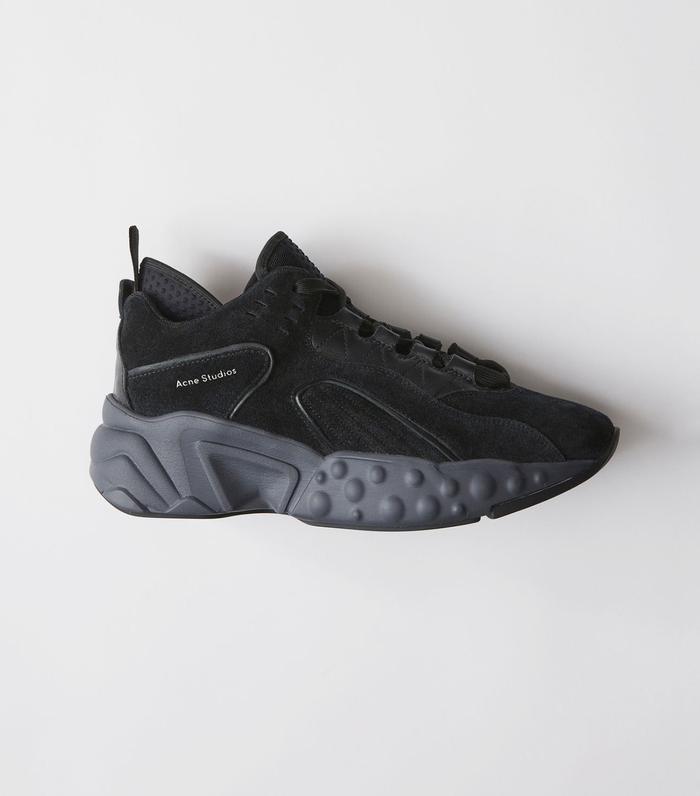 1c0c08e9d9 On Gigi Hadid: Acne Studios Manhattan Multi Black Sneakers ($470). Pinterest