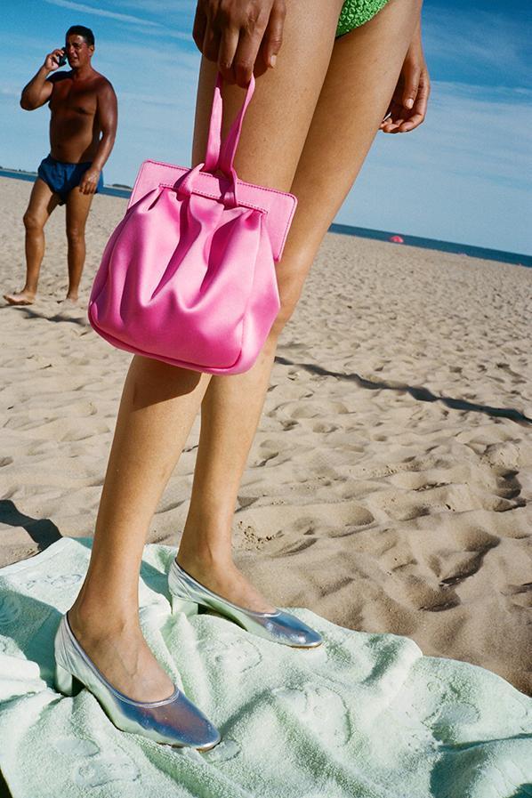 best wedding accessories: pink satin bag