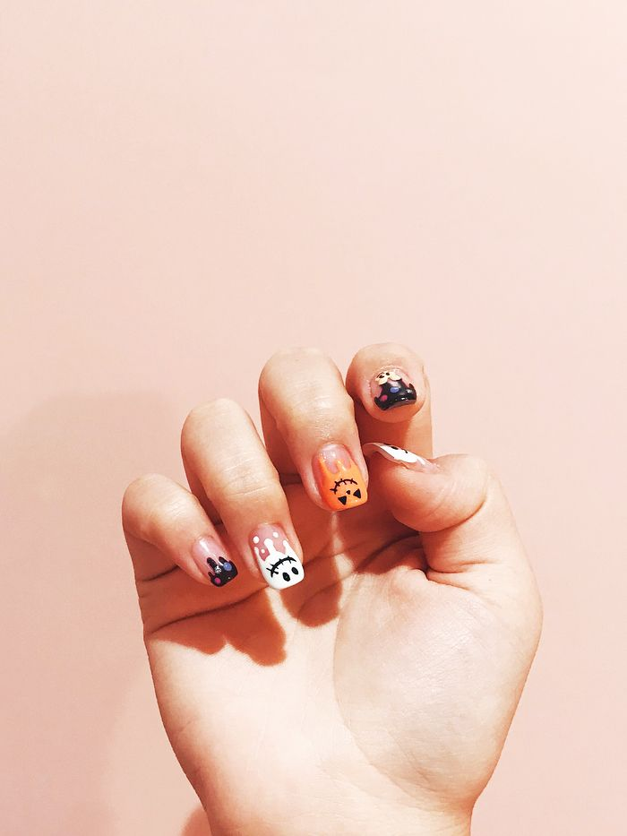 - 25 Orange-and-Black Nail Designs For Halloween Byrdie