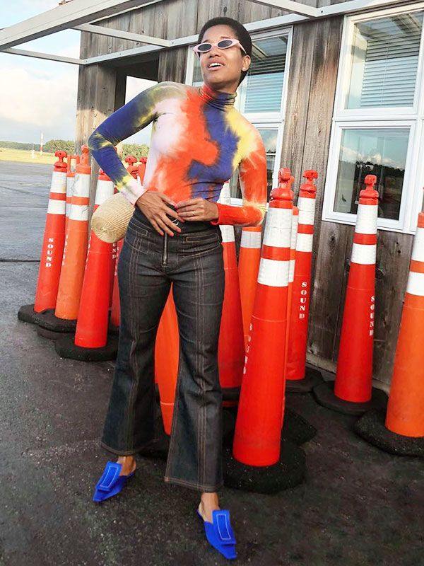 street style blogger Tamu McPherson wearing flat shoes