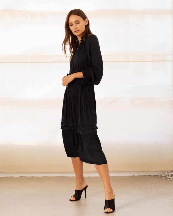 241c41d54d66 17 Long-Sleeve Holiday Dresses to Wear for the Party Season