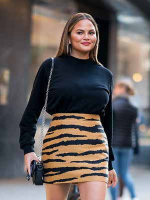 Chrissy Teigen Wore the Skirt-and-Boots Outfit Everyone Will Try to Copy