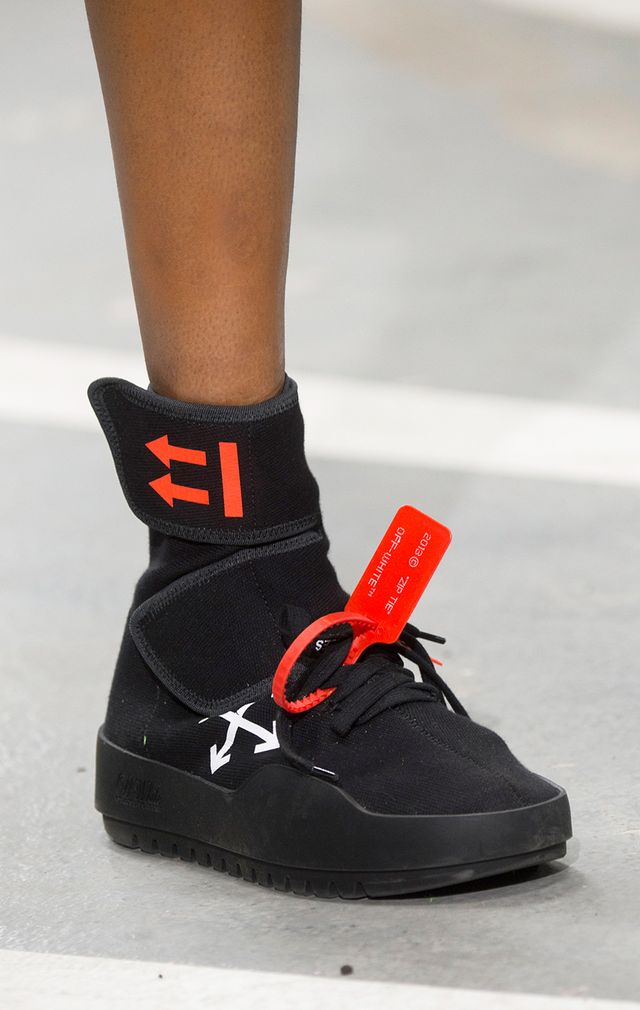 <p>If you were to live in outer space, what would your sneakers look like? Ask yourself that question when buying into this spring sneaker trend. Details like neon logos, neoprene fabrics, and soles...