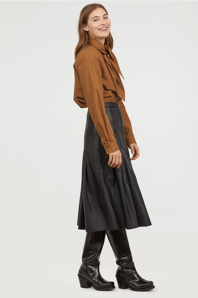 2cb0f1f4f88 20 Leather Midi Skirts You ll Want to Wear All Season