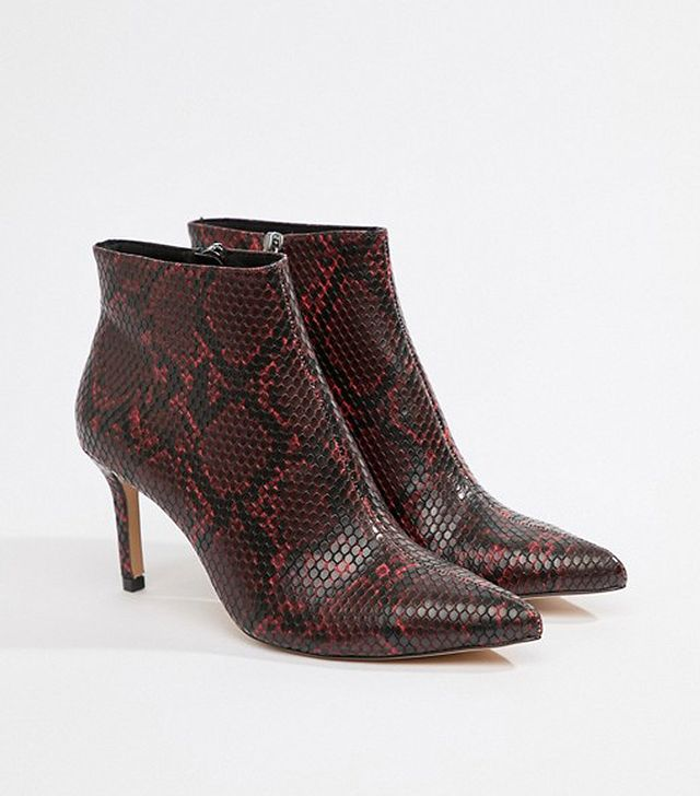 heeled ankle boot in snake print