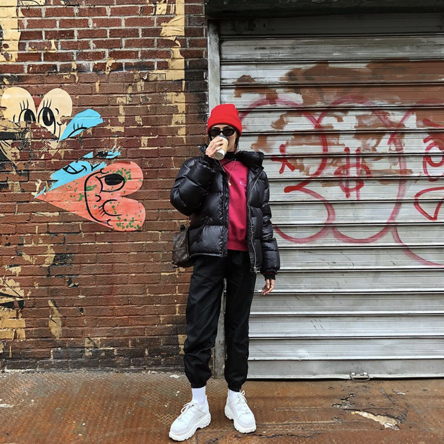 Puffer coat and Fila sneakers outfit