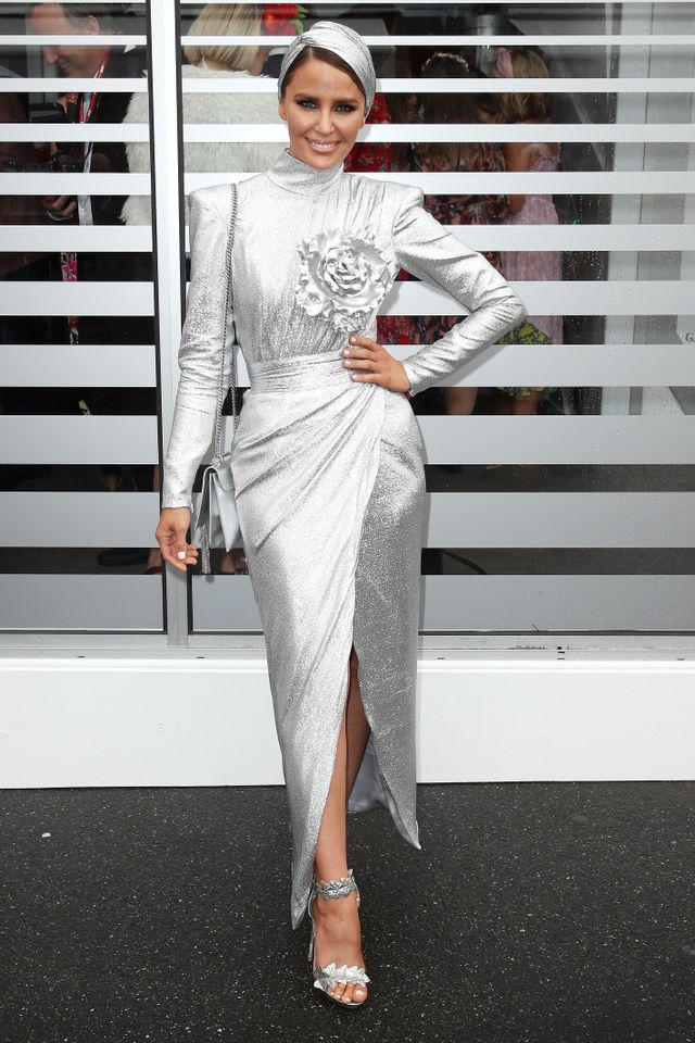 <p>Jodi Anasta wearing a Murley & Co Millnery headpiece and a Roger Viver bag.</p>