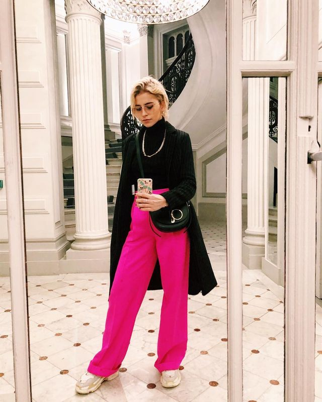 A Holiday Outfit With Bright Pink Pants and Sneakers