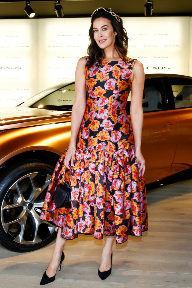 """<p>Megan Gale wearing a floral midi dress and a<a href=""""https://fordmillinery.com.au/"""" target=""""_blank"""">Ford Millnery</a> headpiece.</p>"""