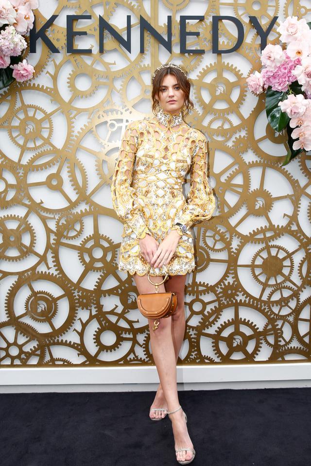 "<p>Montana Cox wearing a gold laser-cut mini dress and a <a href=""https://www.net-a-porter.com/au/en/product/1060192/Chloe/nile-bracelet-mini-leather-shoulder-bag"" target=""_blank"">Chloé..."